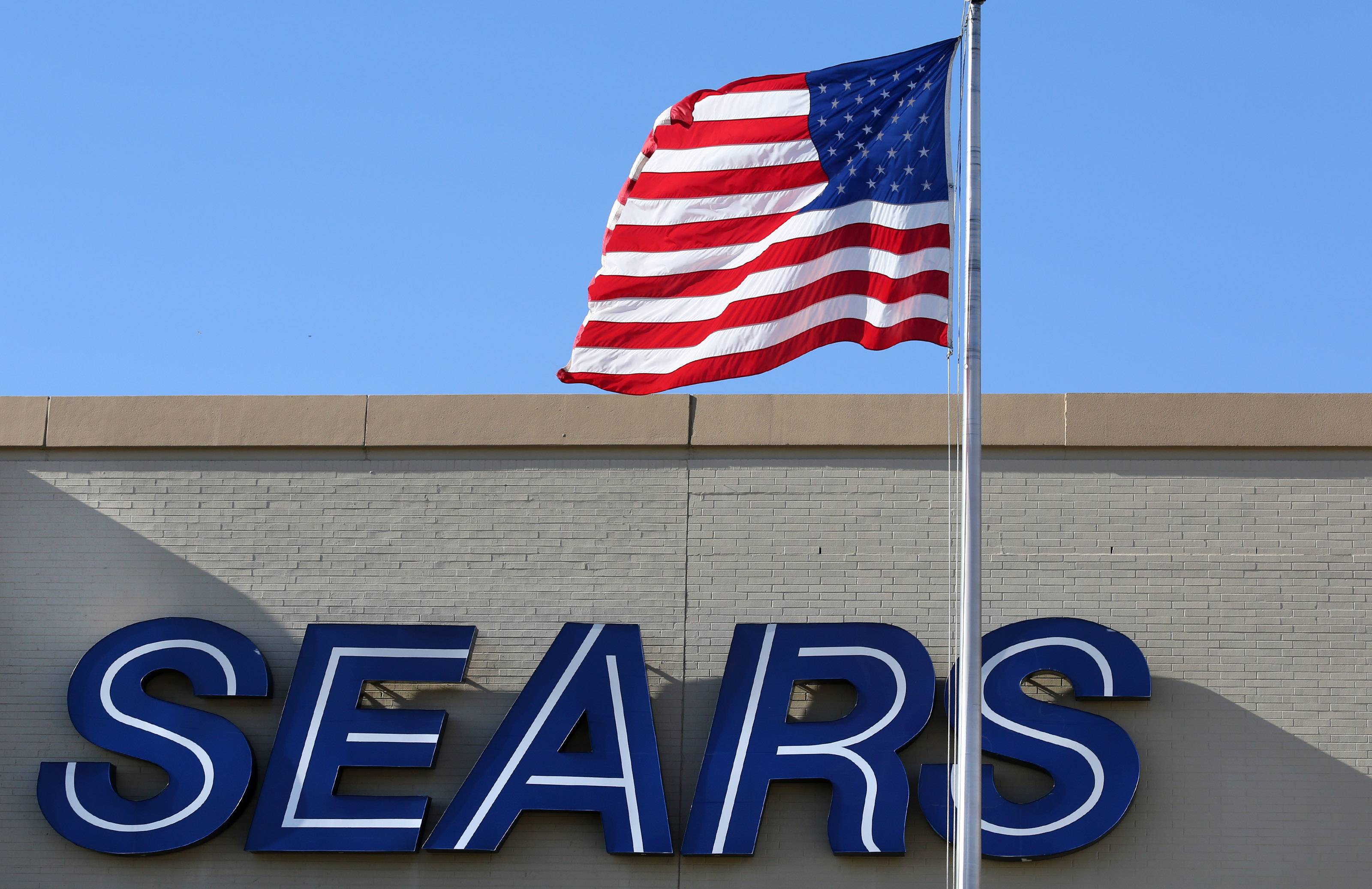 Shoppers stop at Sears at Woodfield Mall in Schaumburg. Despite nine quarters of losses, Sears Holdings officials say they're confident in their plan to please both shoppers and Wall Street.