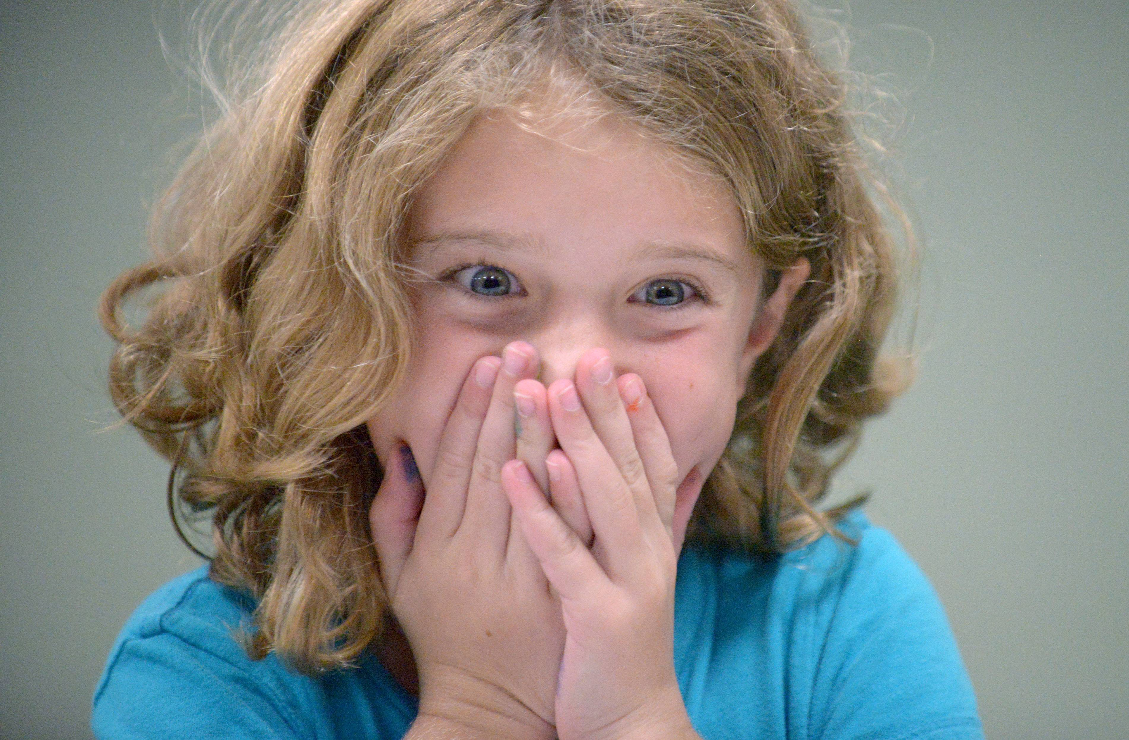 "Morgan Hodgdon, 9, of Geneva, reacts (negatively) to blind taste testing white pepper parmesan cheese popcorn while she and other fourth and fifth graders blind taste tested eight flavors of popcorn in honor of National Popcorn Poppin' Month at the Geneva Public Library on Tuesday. ""It smells good but tastes bad!"" she said. Without knowing what each flavor was, they had to guess what flavor it was and rate each sample on qualities like flavor, texture, crunch and more. It was a hit with the kids, even though they didn't like all the flavors which included Thai coconut curry, rosemary truffle, white pepper parmesan, white cheddar, cheddar cheese, kettle corn, carmel and regular."
