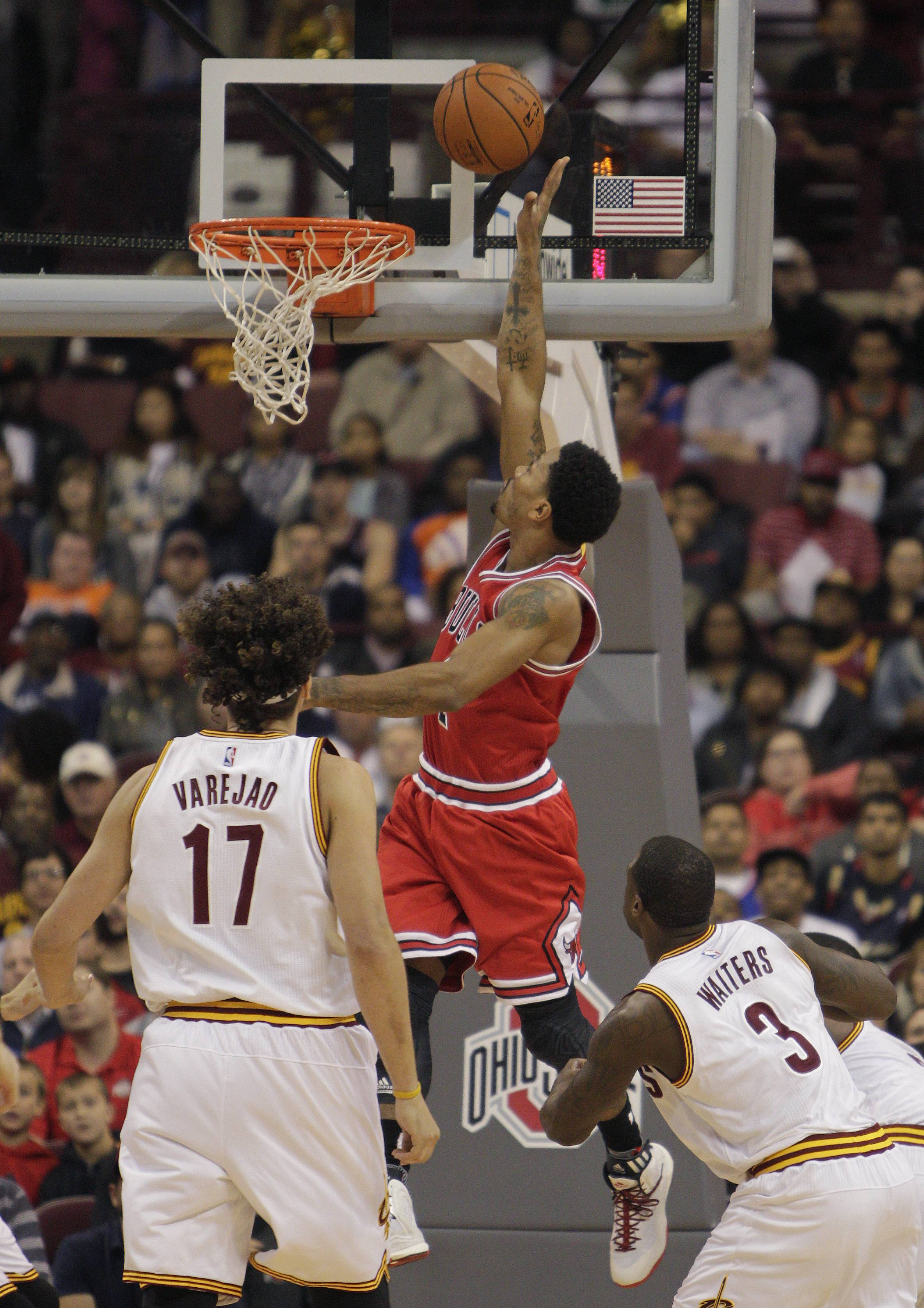 Bulls guard Derrick Rose tips in a rebound against the Cleveland Cavaliers in Monday night's preseason game at Columbus, Ohio. Rose finished with 30 points, playing just 24 minutes.