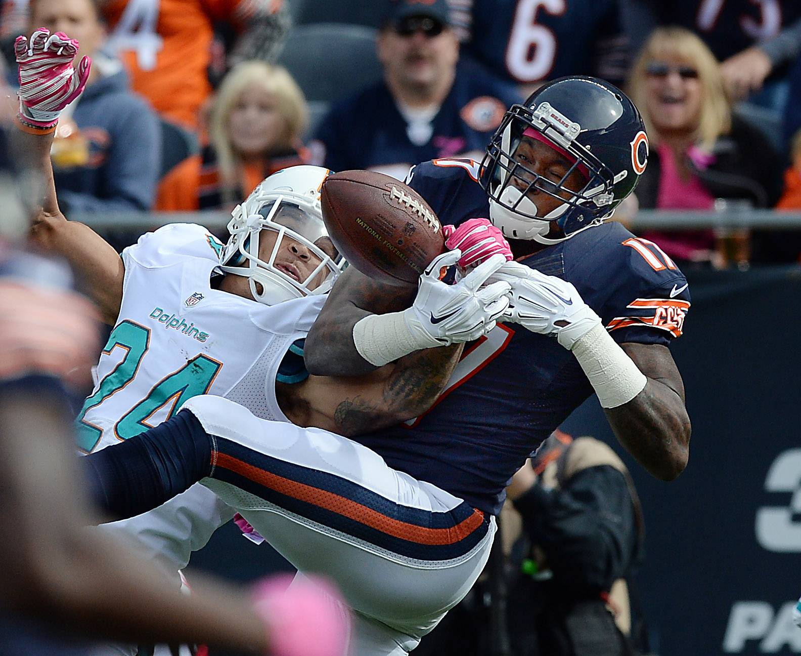 Alshon Jeffery fails to pull in a pass play from Jay Cutler as Miami's Cortland Finnegan breaks up the play in the second quarter Sunday at Soldier Field.