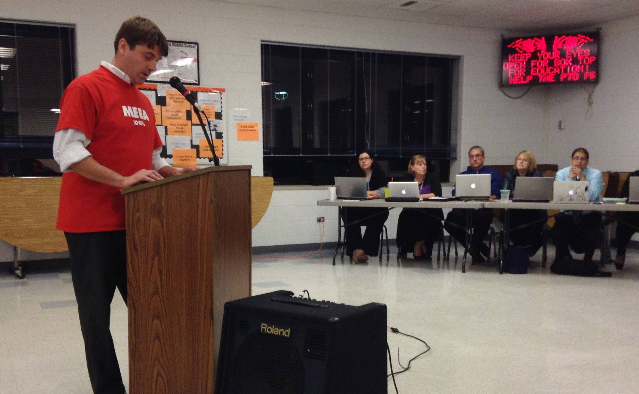 Nick Ciko, co-president of the Mundelein Elementary Education Association, addresses the Mundelein Elementary District 75 school board Monday night. Teachers have been working without a contract since June 30.