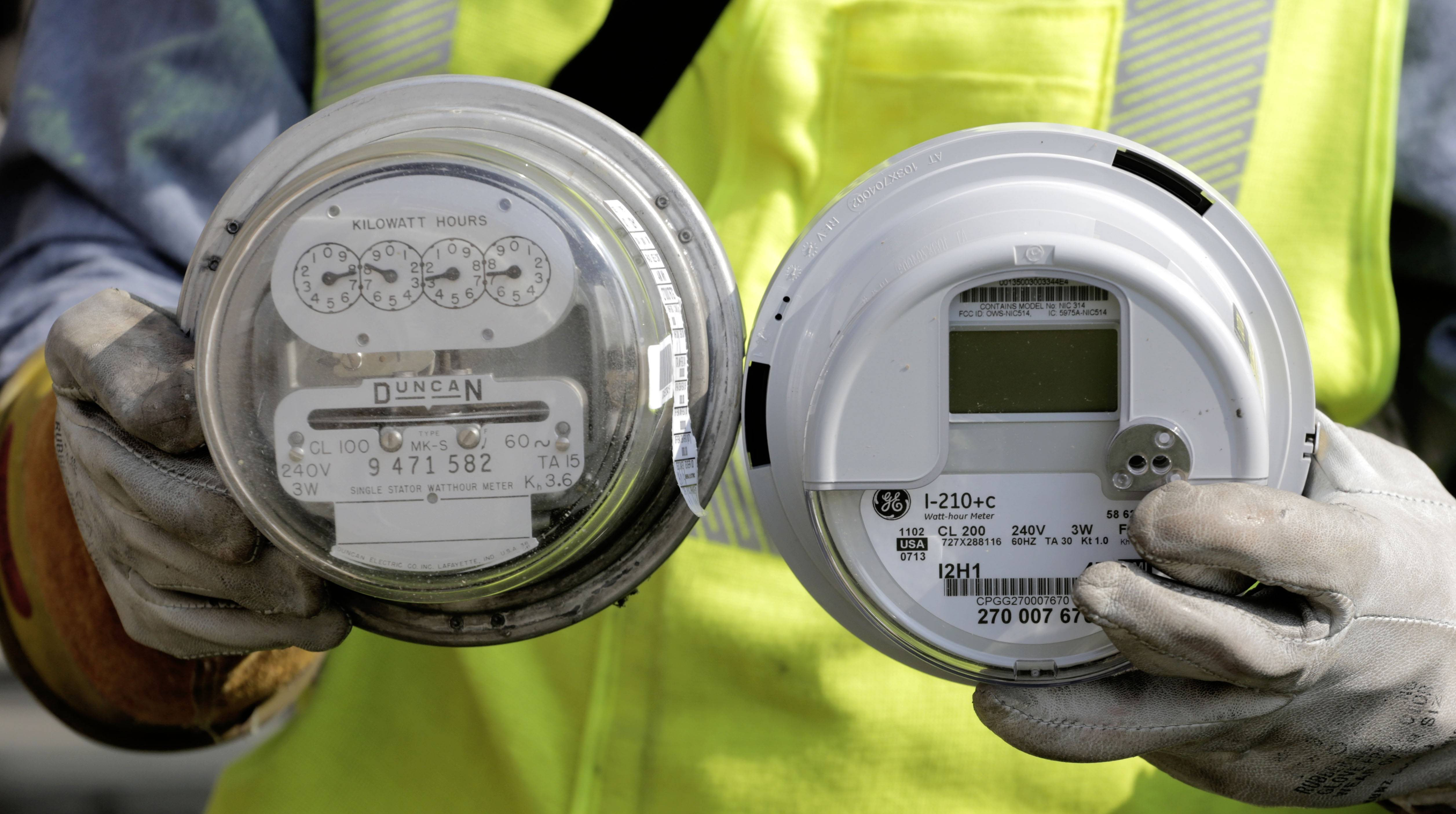 All Arlington Heights residents will have smart meters, like the one on the right here compared to an old one on the left, by October 2015, ComEd says.