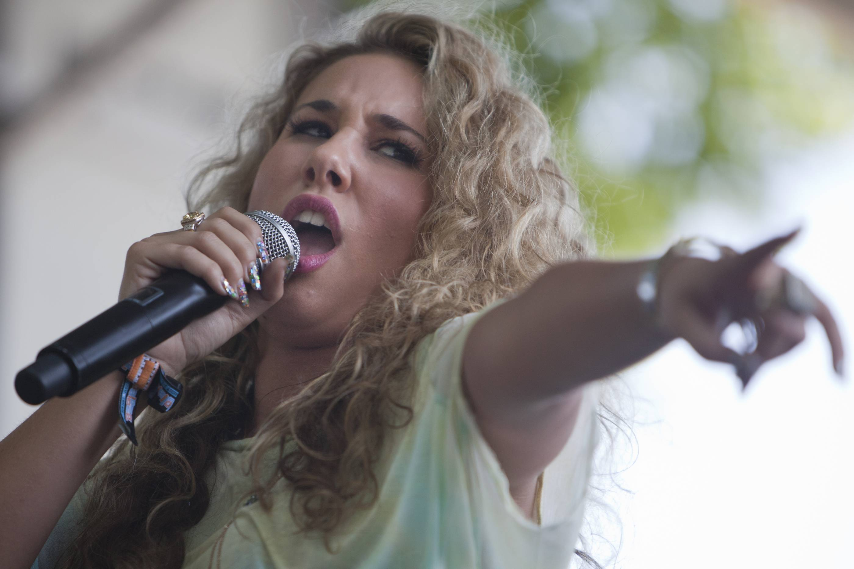 "Wheeling native and ""American Idol"" contestant Haley Reinhart performs during Lollapalooza in August 2012. Reinhart expanded her publishing deal with ole, the independent rights management, it was announced Wednesday."