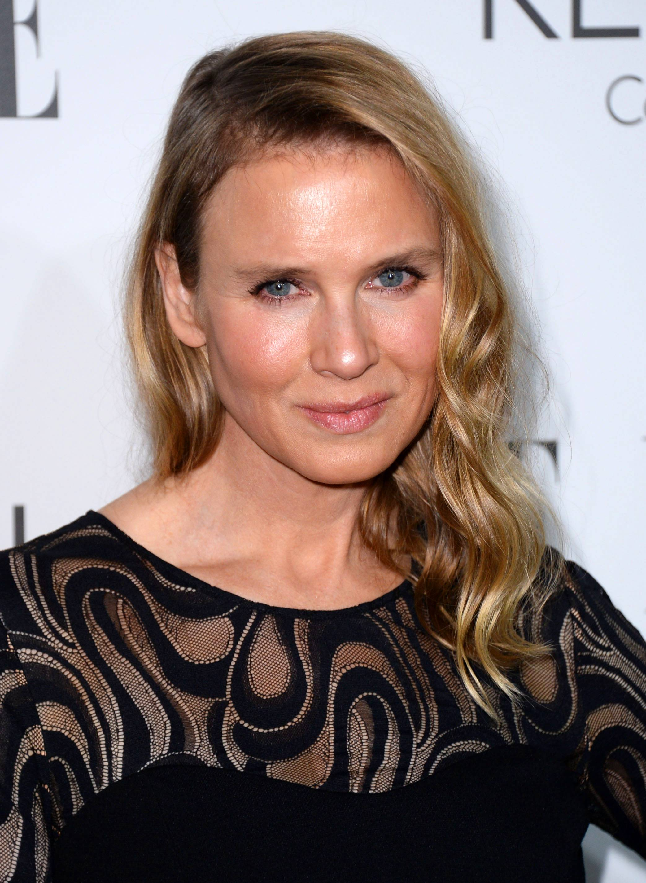 "Renée Zellweger, 45, here at ELLE's 21st annual Women in Hollywood Awards Monday, says she looks different because she's ""living a different, happy, more fulfilling life."""