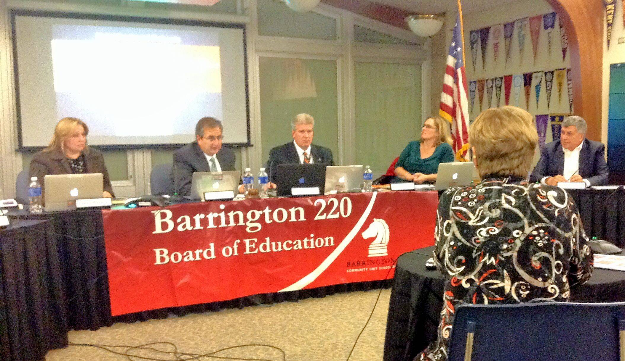 Members of the Barrington Area Unit School District 220 Board of Education listen to a presentation from Linda Klobucher, the assistant superintendent of curriculum and instruction, on the changes to the district's tuition-based full-day kindergarten program.