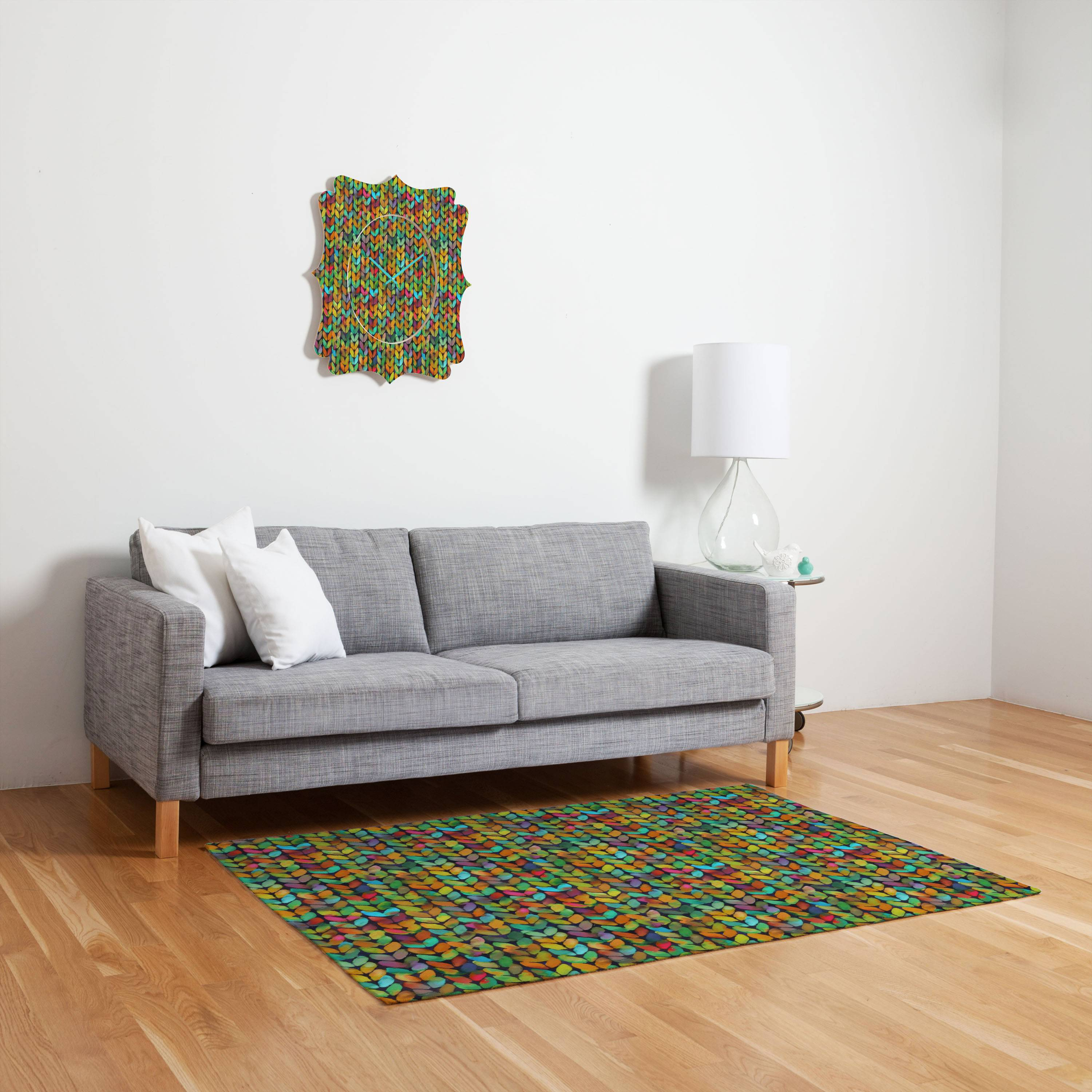 Cozying up in a favorite sweater is one of the distinct pleasures of autumn. This fall, designers and retailers are stitching up sweater motifs on an array of home decor, too, such as this Deny Designs Betsy Olmsted Acid Knit rug, printed with a vibrant and unexpected knitted motif.