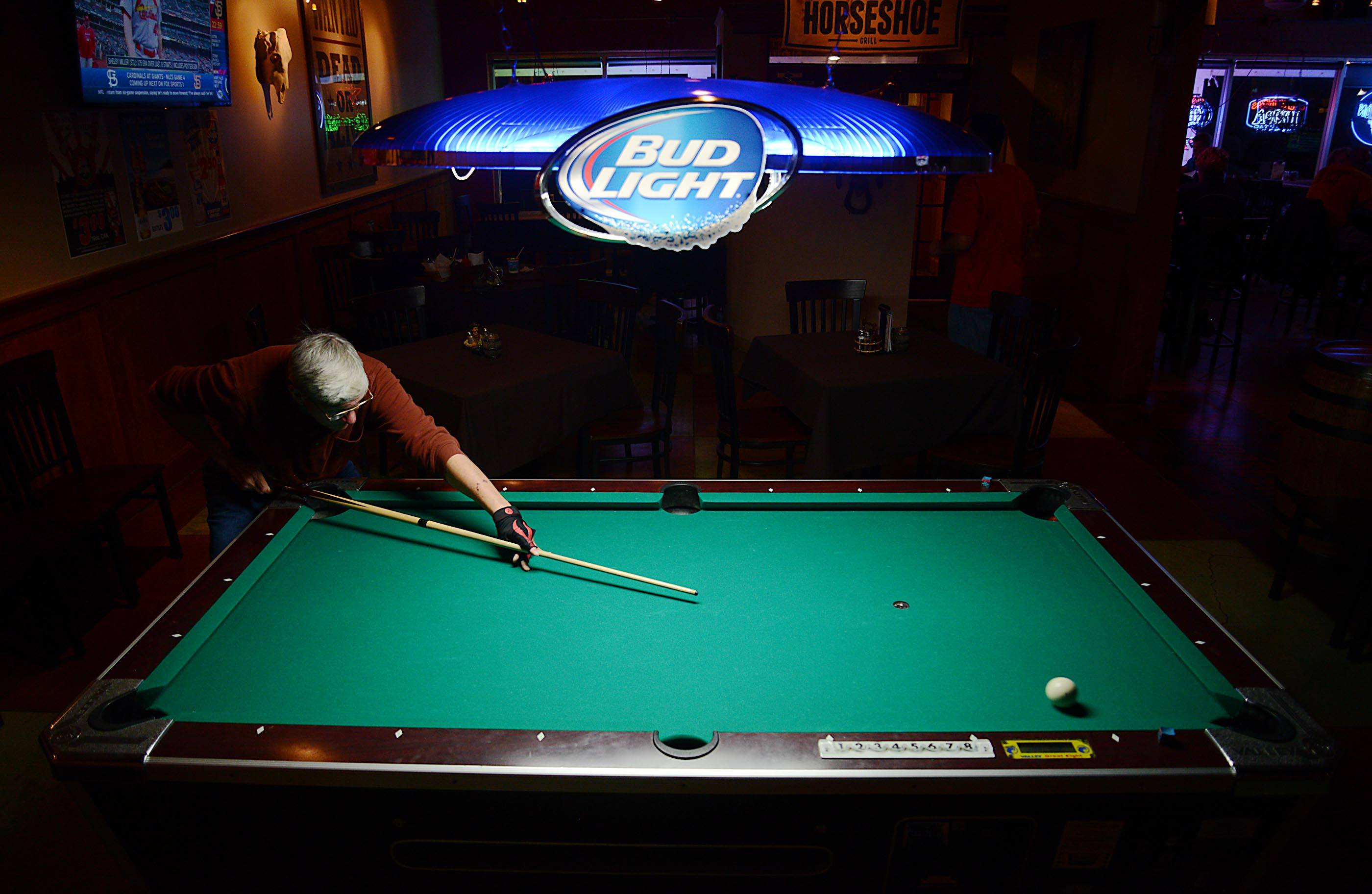 Bob Dorman of Lake Barrington practices his shots on a side-room billiards table at Horseshoe Grill in Lake Barrington.