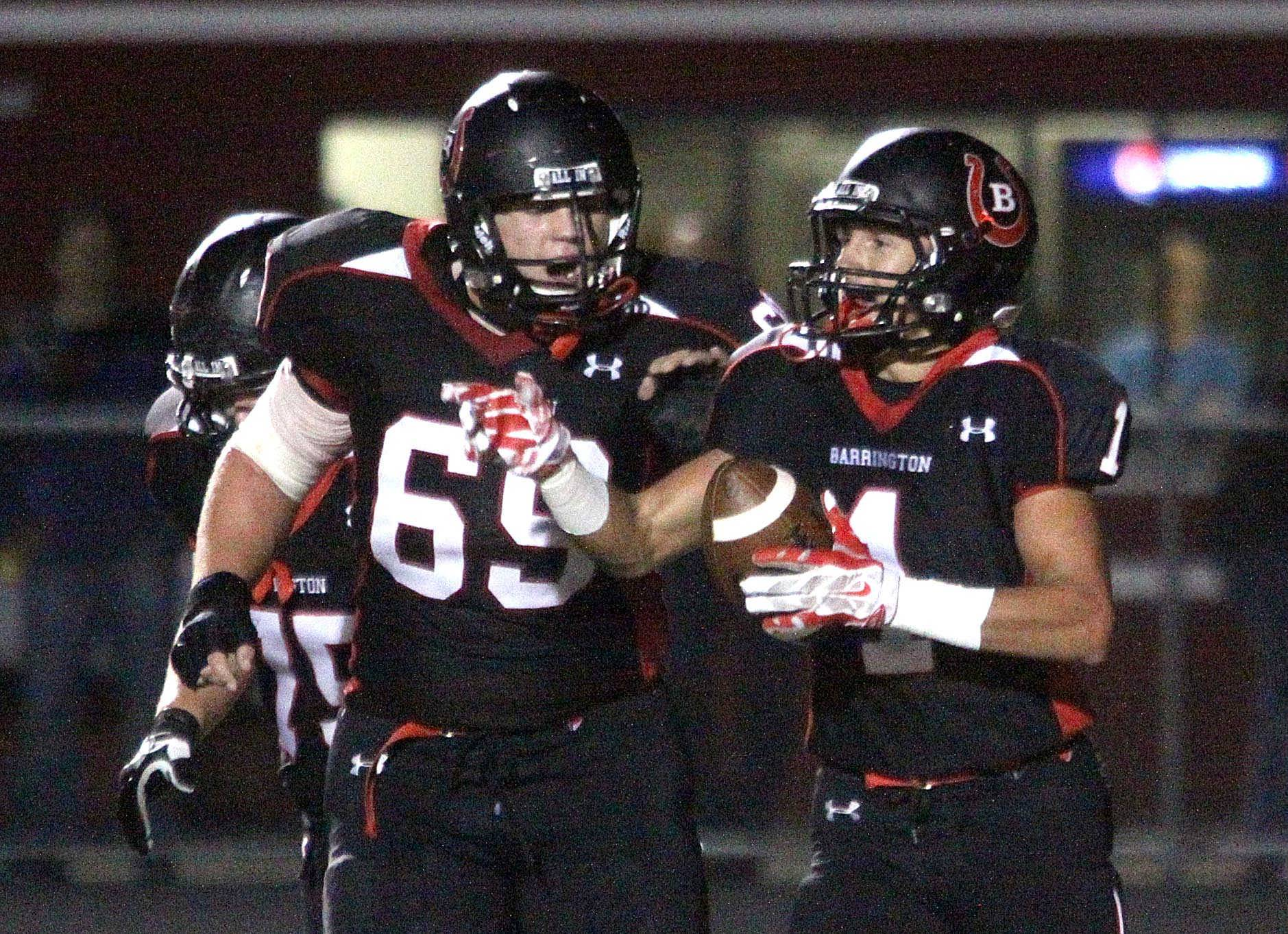 Barrington's Brett Morrison, left, congratulates Scotty Miller after a touchdown against Palatine at Coach Tom Frederick Field in Barrington.