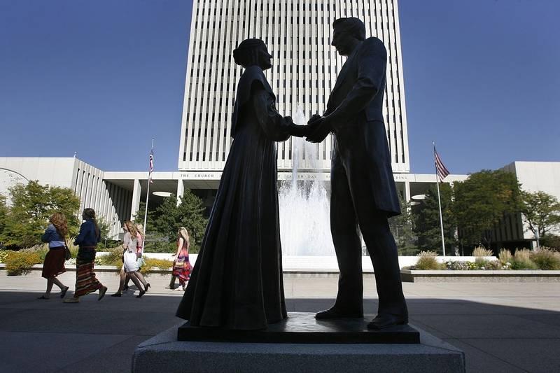 Associated Press/Oct. 6, 2012Women walk by a statue of Joseph and Emma