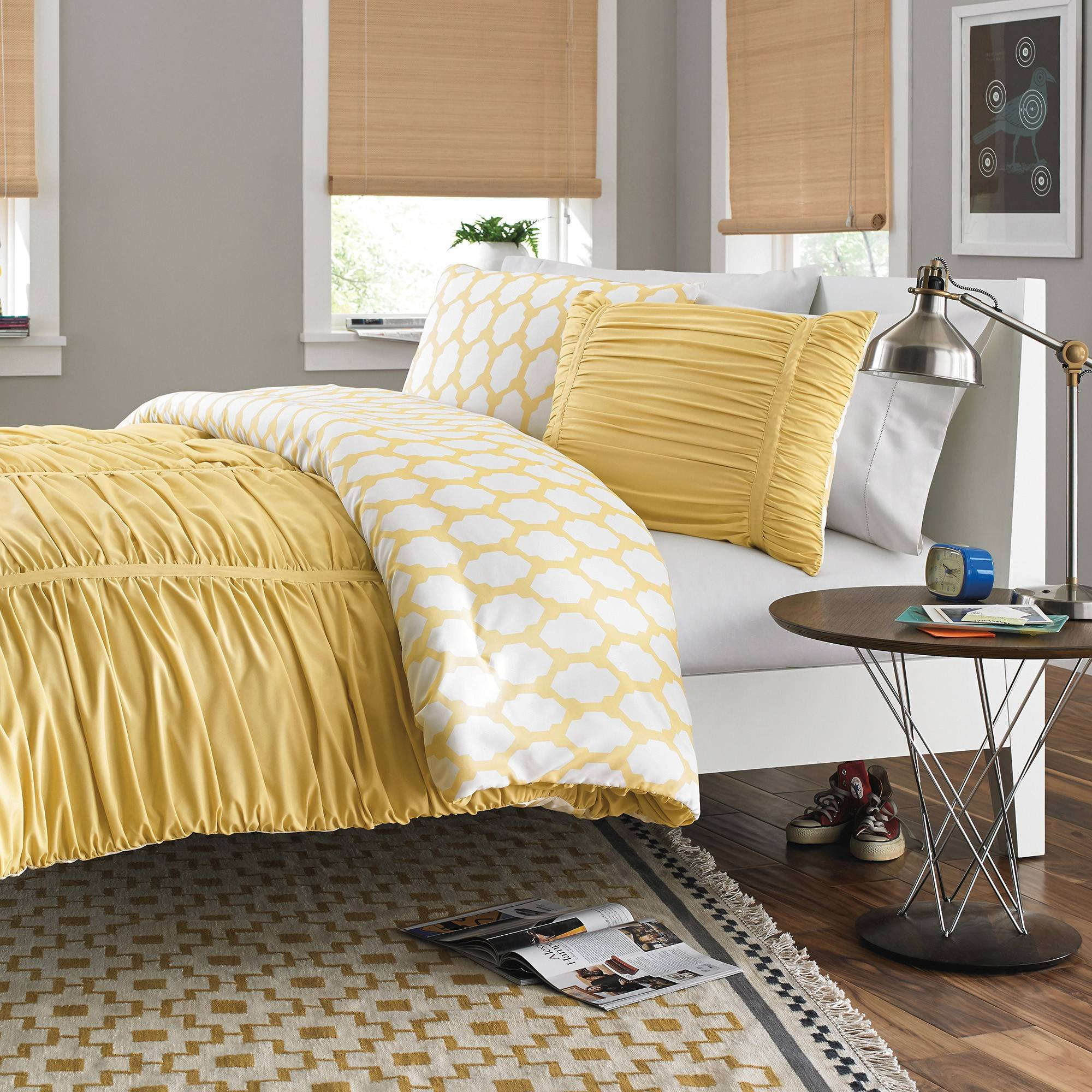 Bedding is one of the easiest ways to let teens express their style, and a reversible comforter such as the Reagan Reversible Comforter Set in Pale Banana gives them an extra option for changing the room's look.