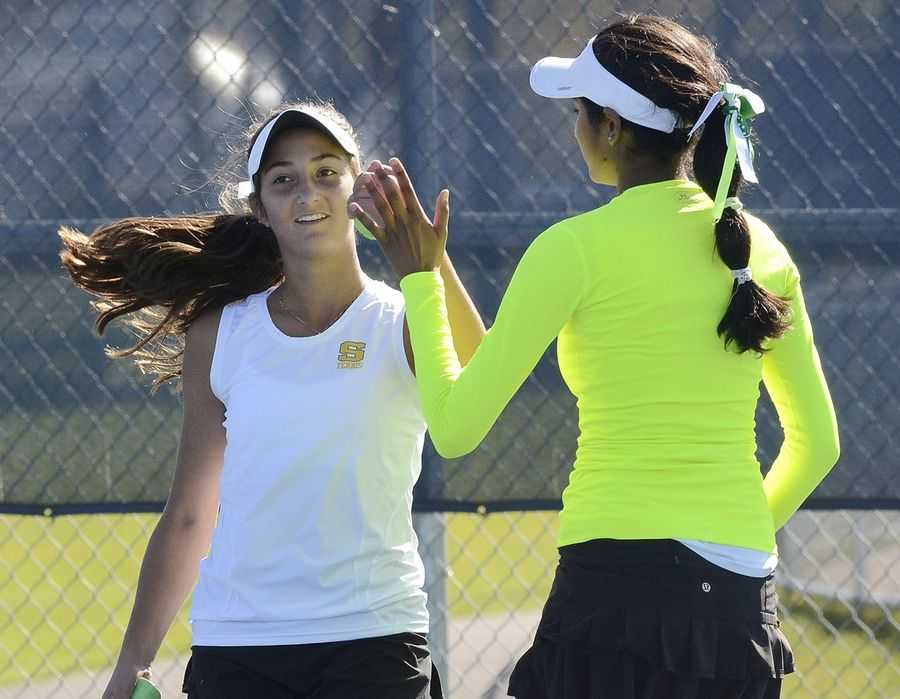 Stevenson's Kate Harvey, left, and Vinaya Rao congratulate one another while on their way to a doubles state championship against Erica Oku and Stephanie Dolehide of Hinsdale Central on Saturday.