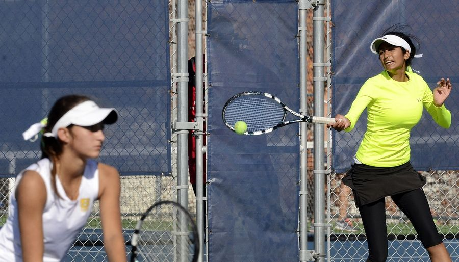 Stevenson's Kate Harvey, left, and Vinaya Rao, on their way to defeating Erica Oku and Stephanie Dolehide of Hinsdale Central in the doubles state championship match at Buffalo Grove on Saturday.