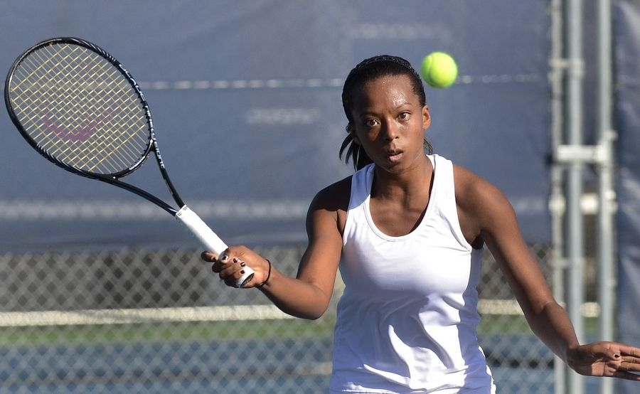Brienne Minor of Carmel competes during her singles semifinal victory on Saturday at Buffalo Grove.