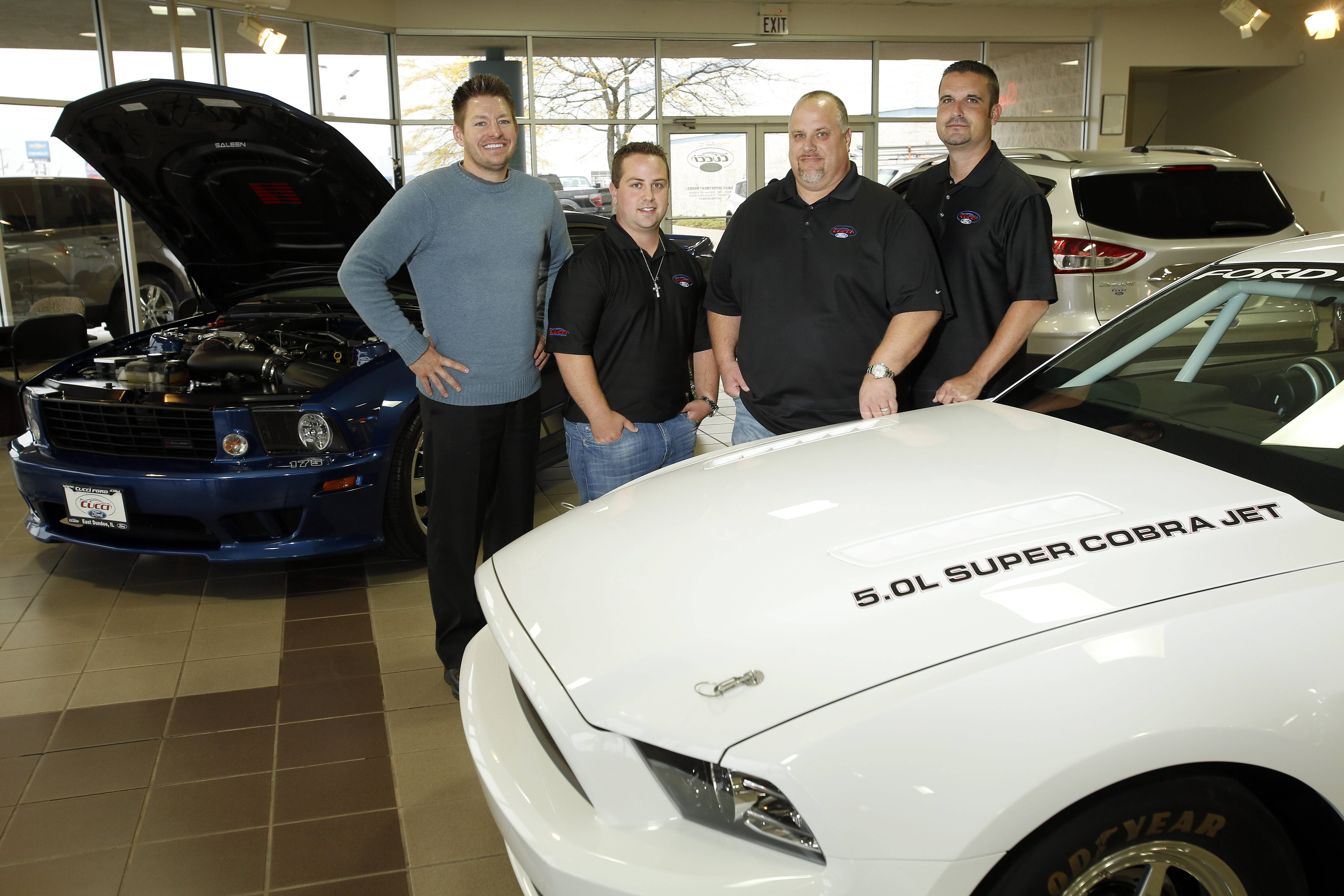 Mitch Lewandowski, from left, Nicholas Cucci, Theodore Cucci, and Neil Becker of Cucci Ford in East Dundee Tuesday.