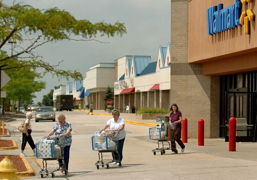 Shoppers exit the Wal-Mart on Rand Road in Lake Zurich. Home-rule designation would allow the village to increase the sales tax.