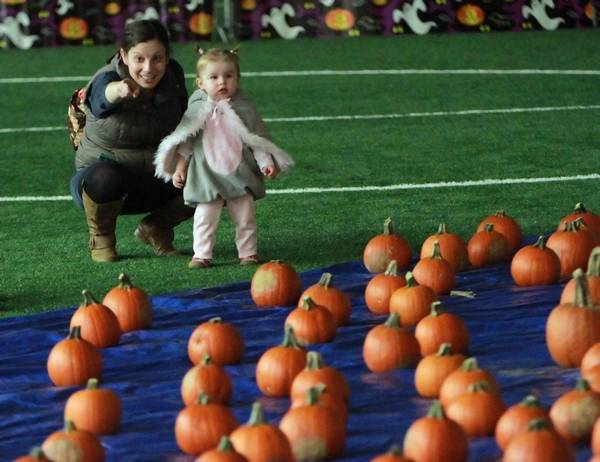 katie olakowski of libertyville and her 1 year old daughter posie check