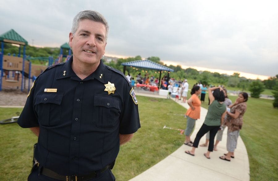 Naperville Deputy Chief Brian Cunningham visits one of 37 National Night Out events in August, where police collected unwanted or expired prescription drugs.