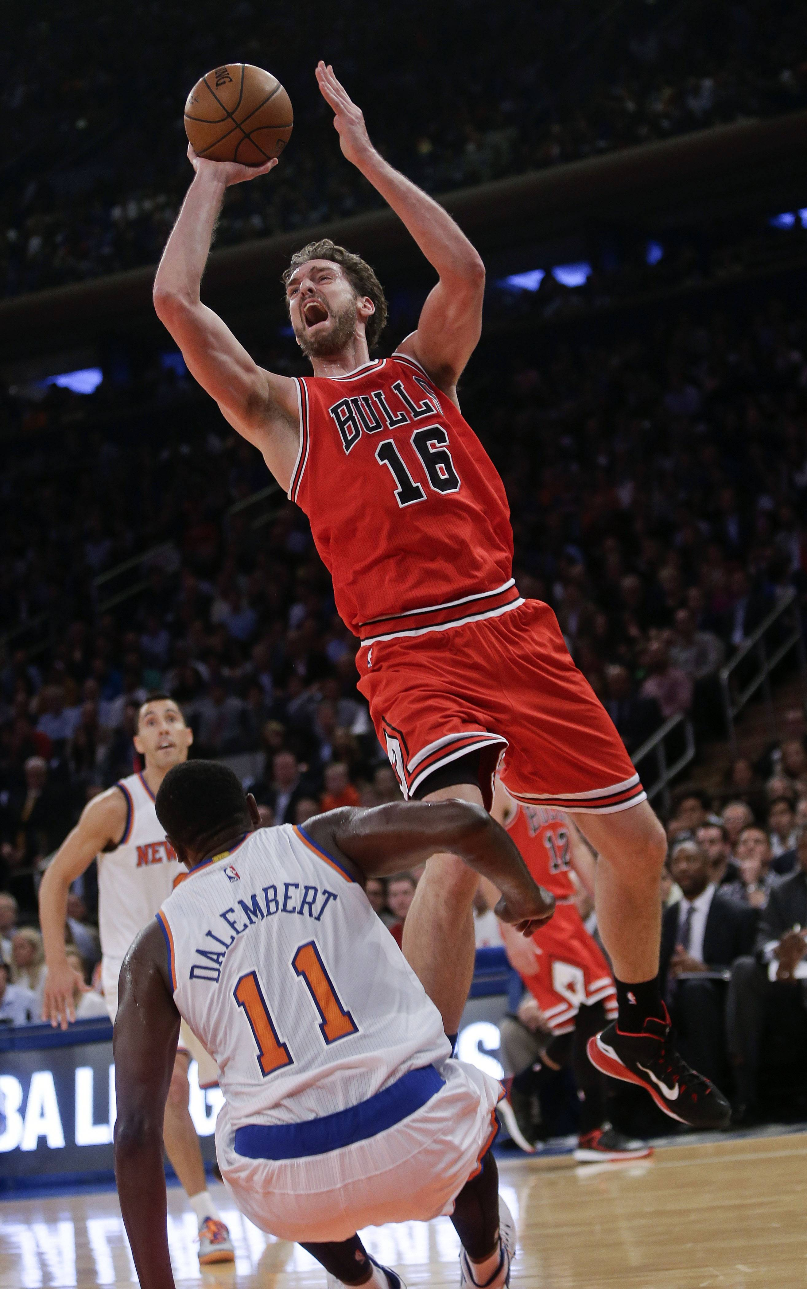 Pau Gasol shoots over the Knicks' Samuel Dalembert in Wednesday night's season-opening victory at New York. Gasol finished with 21 points and 11 rebounds in his Bulls debut.