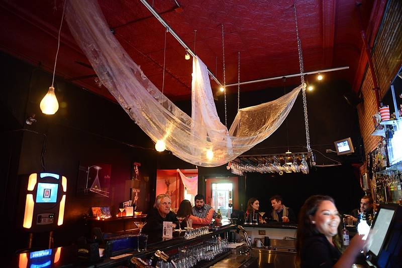 halloween decorations hang over the bar at the martini room in elgin