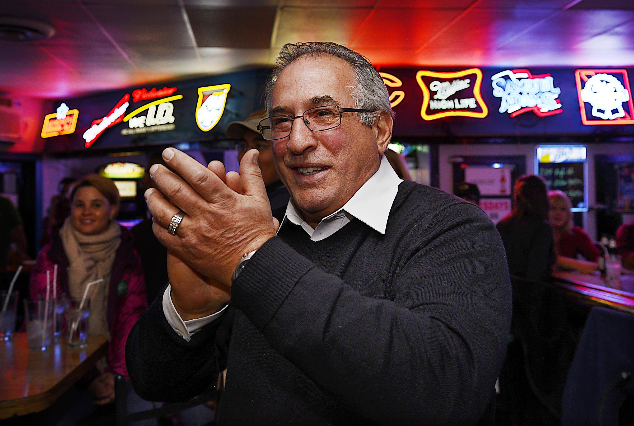 Democratic incumbent State Rep. Marty Moylan applauds Election Night results at The Bar in Des Plaines that showed him defeating Republican challenger Mel Thillens.