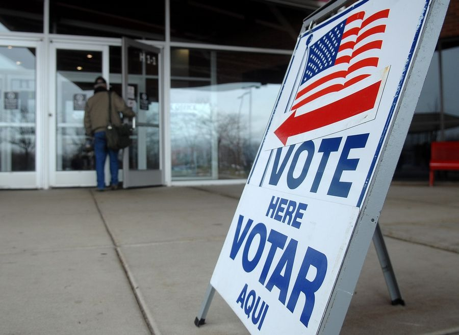 Voters arrive at their polling place at Elgin Community College Tuesday.