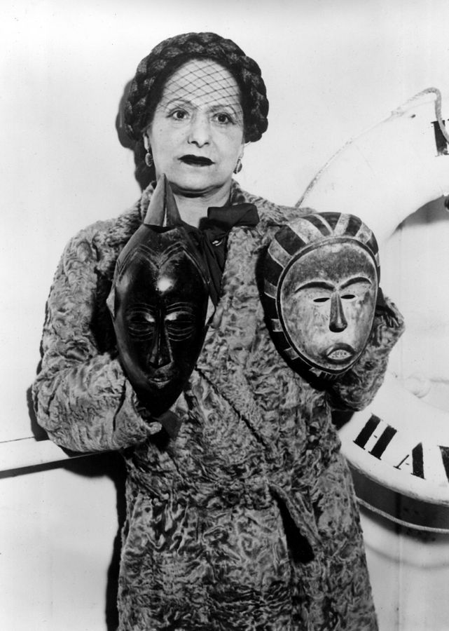 7599a3fe5d3 Businesswoman Helena Rubinstein shows two masks from her collection that  she will exhibit in New York