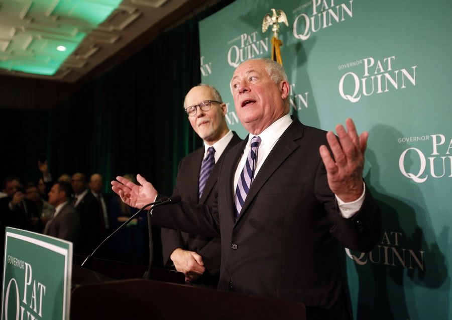 Gov. Pat Quinn, right, speaks from his election party at the Hotel Allegro in Chicago Tuesday.