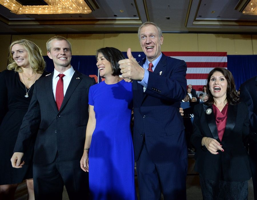 Republican Bruce Rauner celebrated his election as governor Tuesday with wife Diana and running mate Evelyn Sanguinetti of Wheaton.