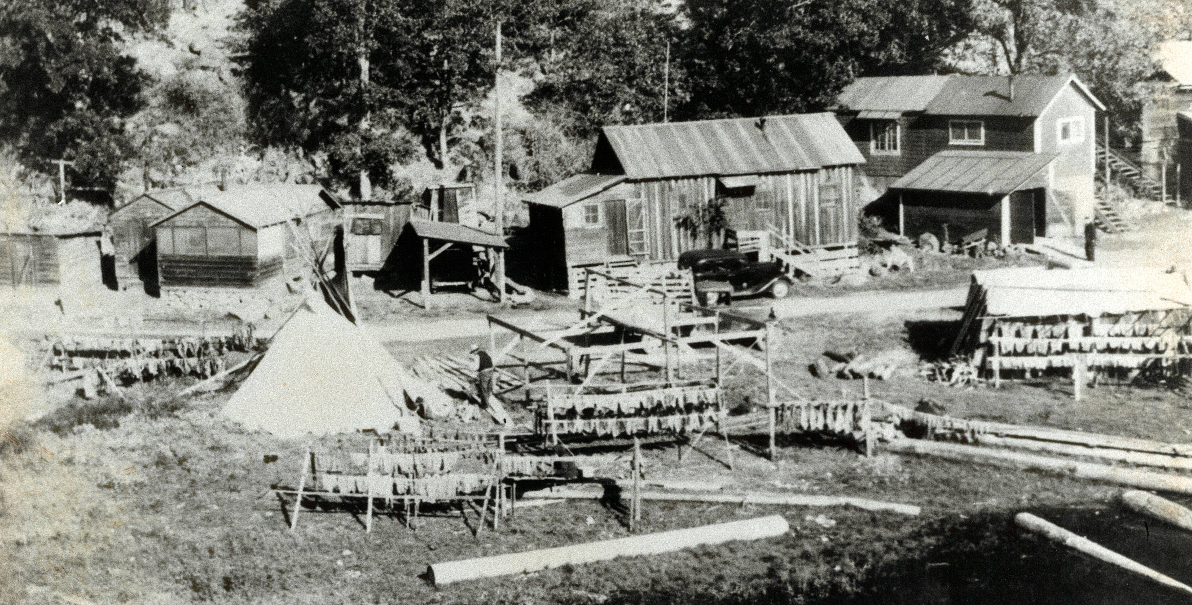 A Native American village at the mouth of the White Salmon River and the Columbia River in Washington state, in the 1930s, before the area was flooded by the Bonneville Dam.