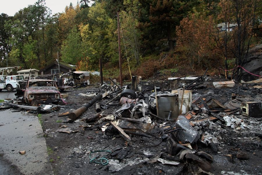 The charred remains of a Native American home and other structures at the Underwood fishing site last month.
