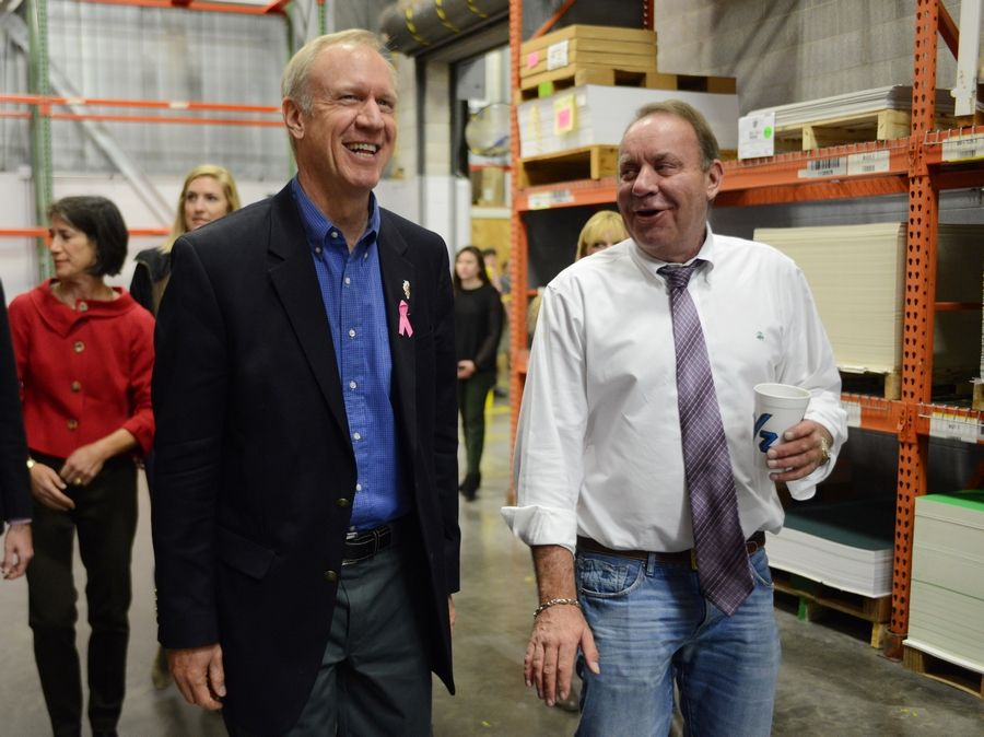 Governor-elect Bruce Rauner, left, toured Crescent Cardboard in Wheeling with owner-CEO Scott Ozmun during the last days of the campaign.