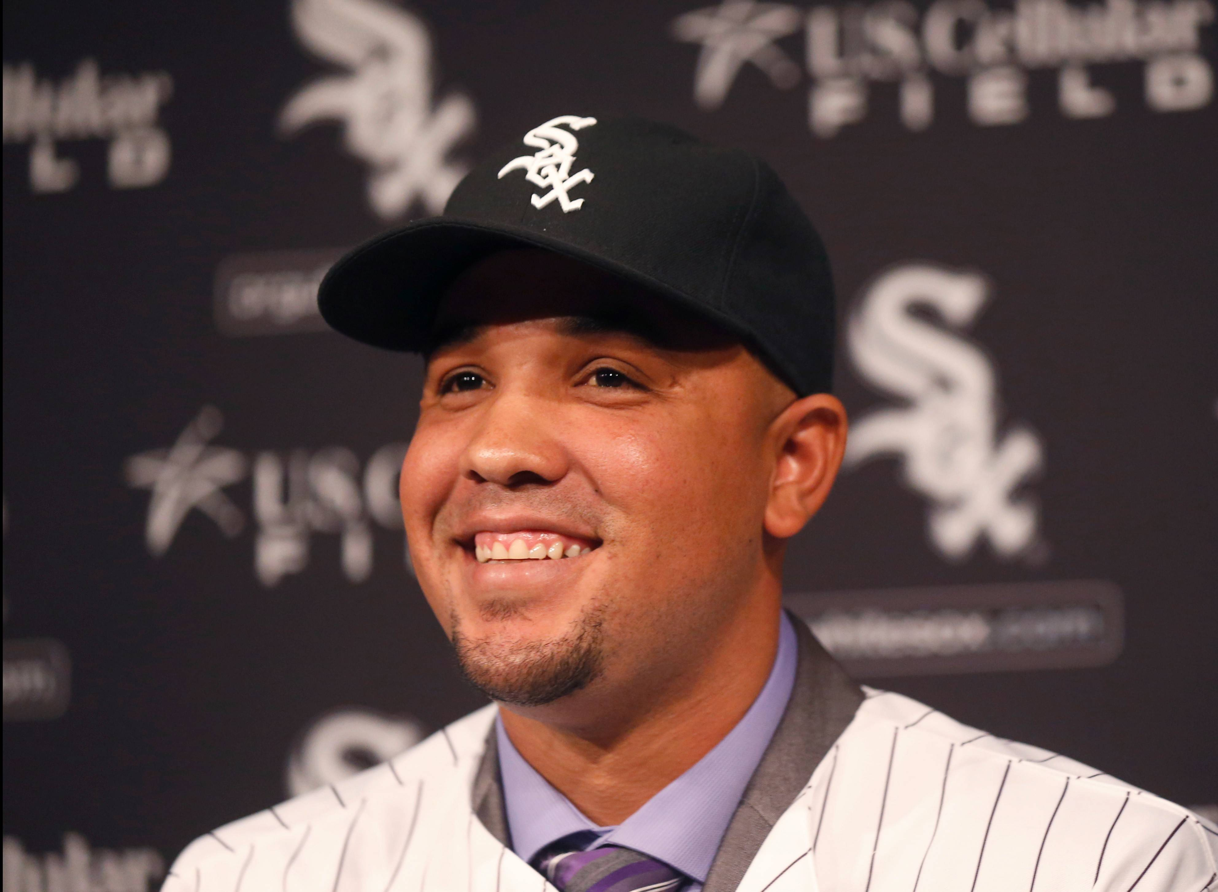 Cuban slugger Jose Abreu smiles during a news conference where the Chicago White Sox announced a six-year, $68 million deal with Abreu Tuesday, Oct. 29, 2013, in Chicago.