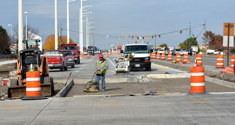 As crews work Friday on Route 59 on the Naperville/Aurora border, Hollywood Palms owner Ted Bulthaup is asking the city of Naperville and the Illinois Department of Transportation to clean up the site before work is suspended for the winter.