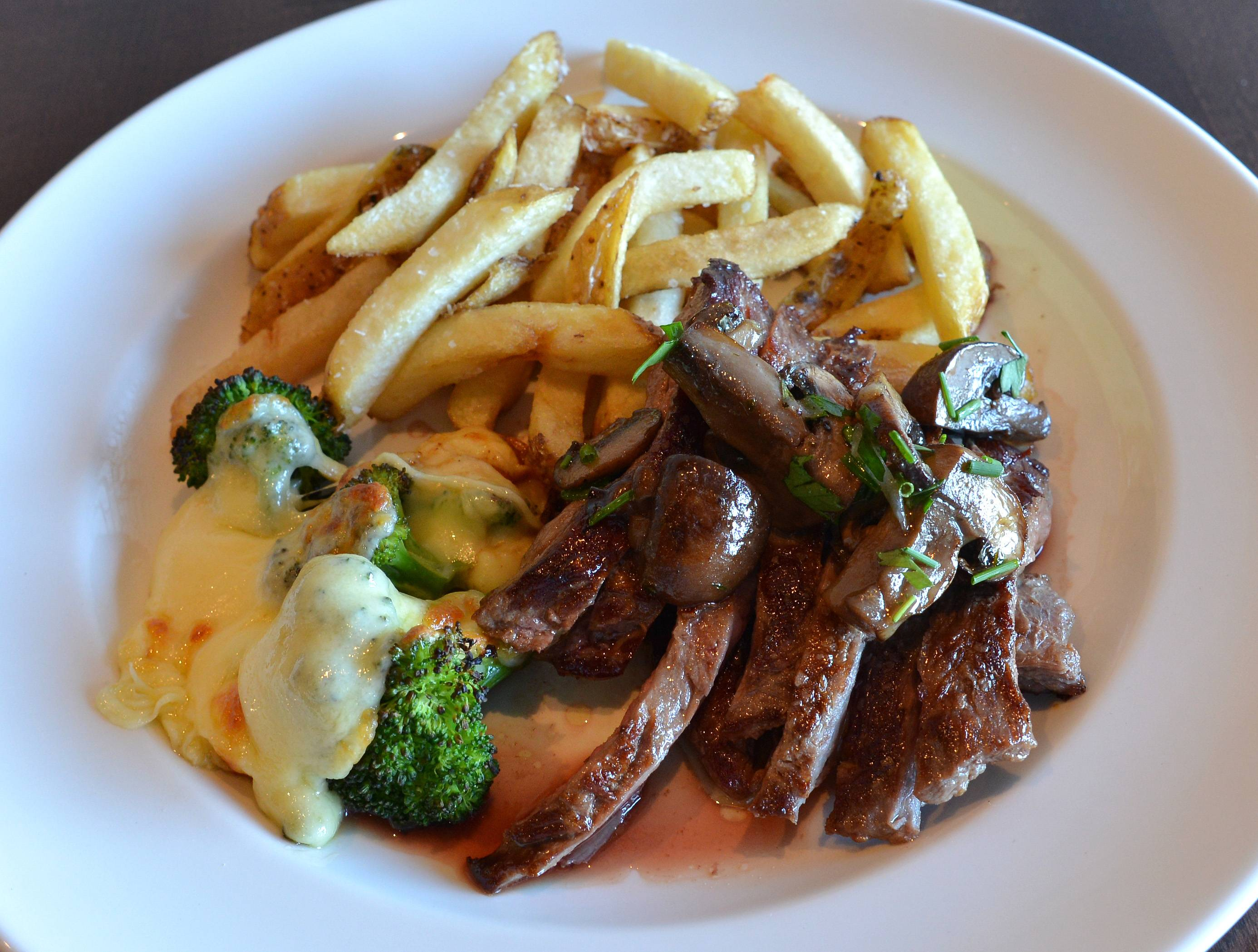 Comfort food is kicked up a notch at Vistro, the latest by chef Paul Virant. Marinated skirt steak, for example, is topped with mushrooms and herb butter and paired with broccoli, cheese curds and french fries.