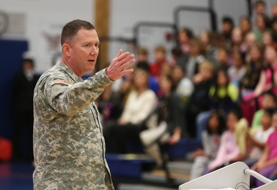 Illinois National Guard Brig. Gen. Richard Hayes addresses students at Frederick School on Tuesday during the Grayslake school's Veterans Day assembly. The event also featured the Drill Team and Color Guard from Great Lakes Naval Station.