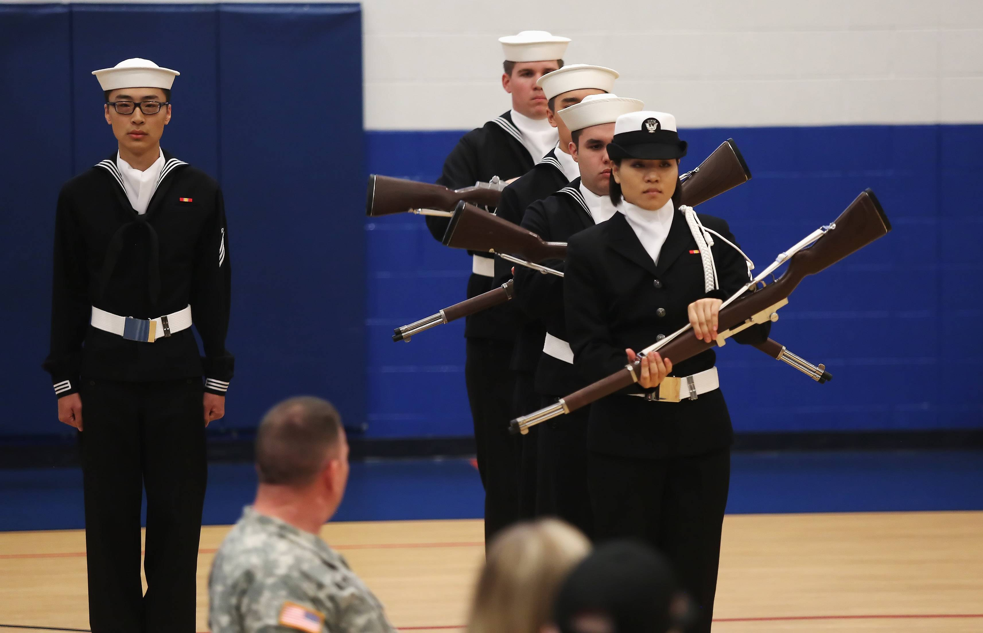 The Drill Team from Great Lakes Naval Station performs during the Veterans Day assembly Tuesday at Frederick School in Grayslake. The event was one of many held across Lake County on Tuesday to honor local veterans.