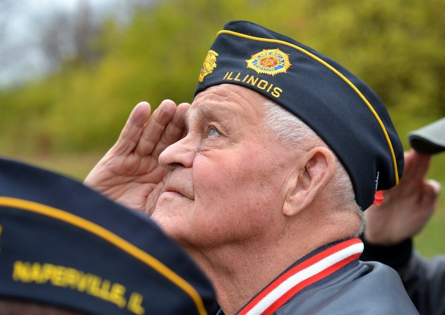Former Army Cpl. Don Wehrli of Naperville salutes during the national anthem as the city marks Veterans Day with a ceremony in Veterans Park.