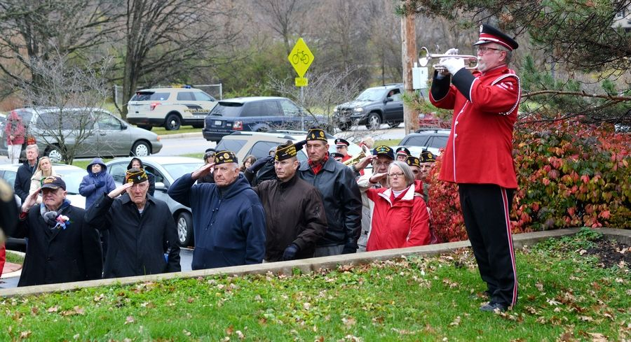 Naperville Municipal Band member Jim Cross plays taps on Tuesday to conclude Naperville's Veterans Day ceremony.