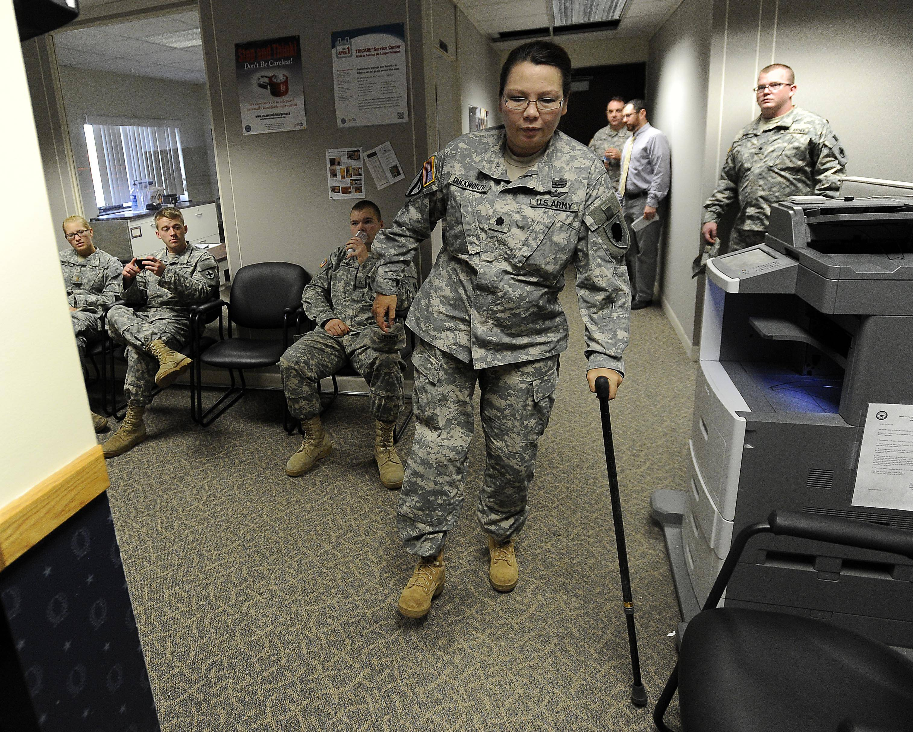 Tammy Duckworth walks through a building at the Illinois National Guard's Camp Lincoln in Springfield on her final drill weekend in the military.