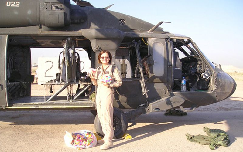Then-Capt. Tammy Duckworth and her Black Hawk helicopter