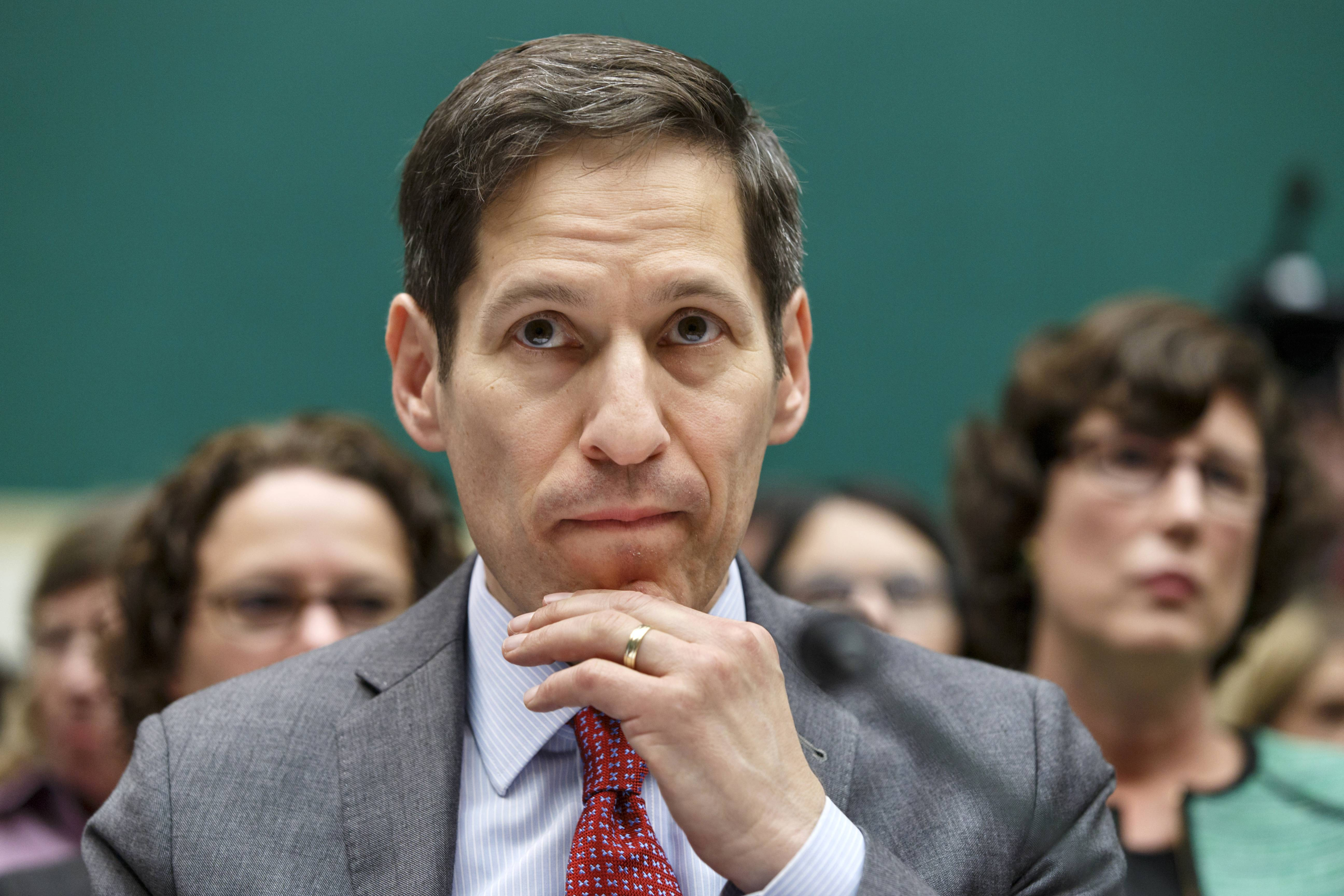 Centers for Disease Control and Prevention (CDC) Director Dr. Tom Frieden listens as he testifies on Capitol Hill in Washington. Health workers on the front-line of the Ebola crisis say the need for urgent help isn't letting up, as Congress begins considering the $6.2 billion emergency aid request.