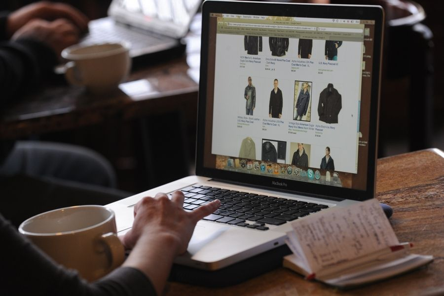 A woman shops online during a past Cyber Monday. Online sales are expected to increase this year, and so could the hackers.