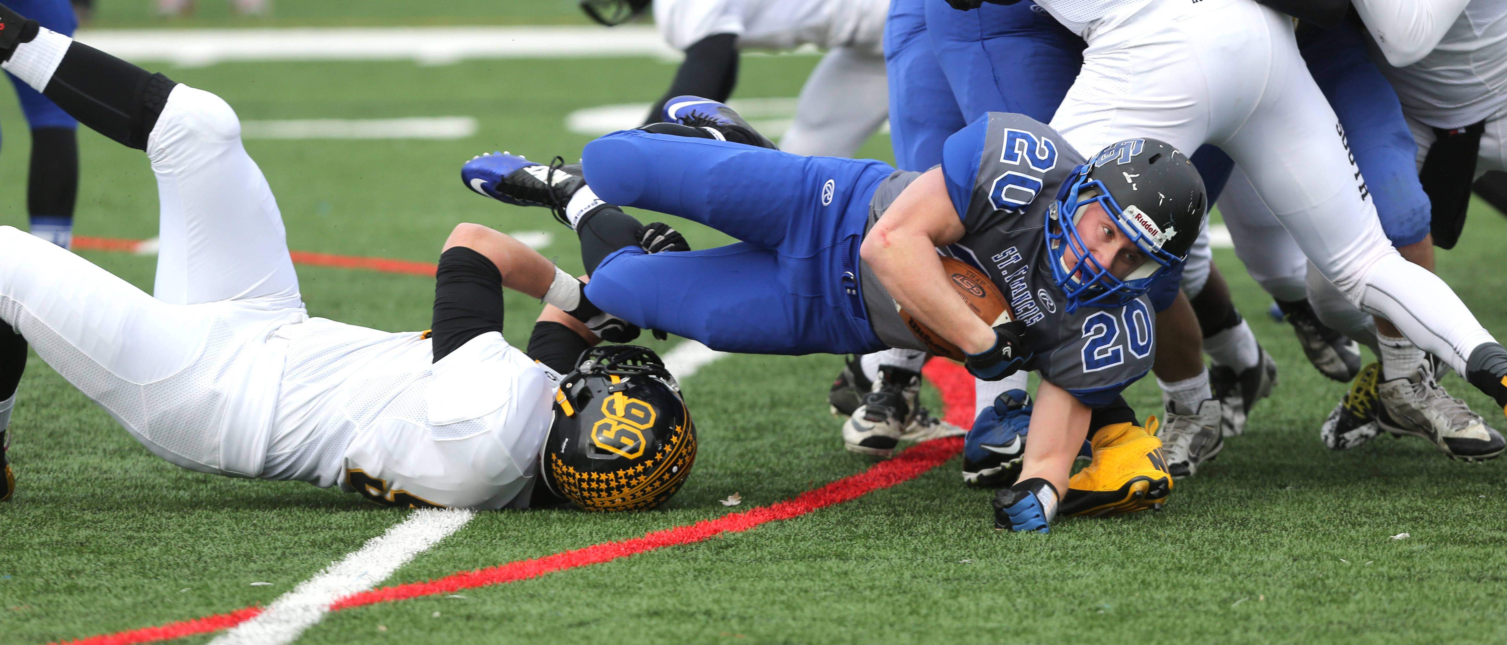 St. Francis running back Steven Fassnacht gains yardage against Hinsdale South.