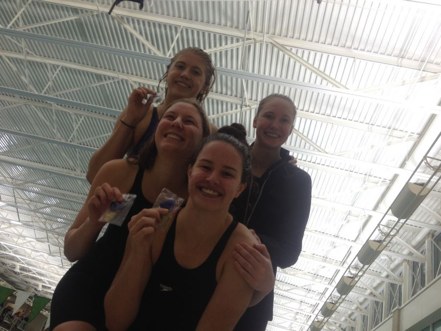 Fremd's pool record 400-yard freestyle relay of, clockwise from bottom, Grace Kneller, Julia Portmann, Loretta Stelnicki and Erica King, after their victorious effort at Stevenson on Saturday.