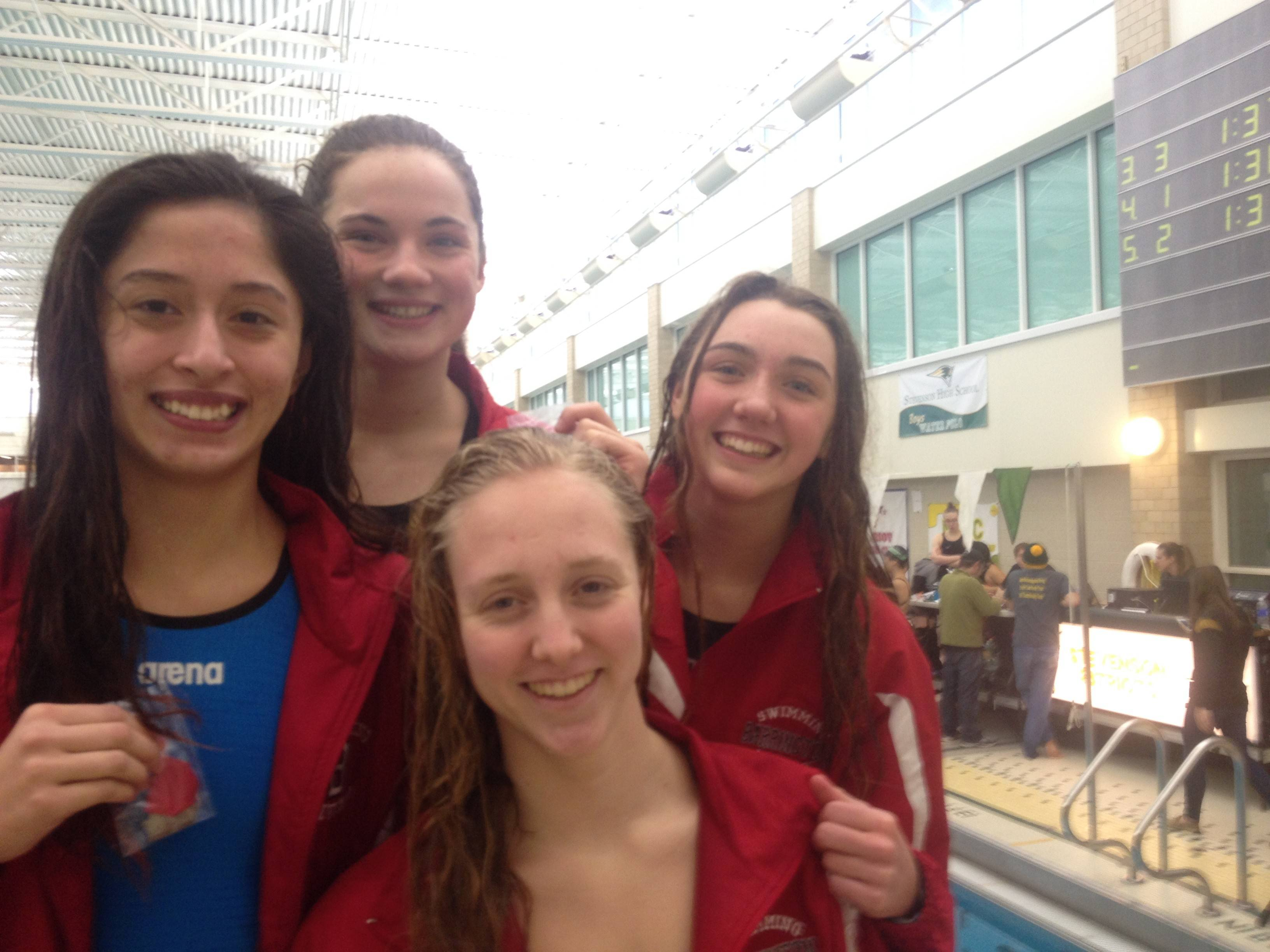 From left, Barrington's Andrea Vega, Emma Barnett, Kirsten Jacobsen and Sara Kate Capel after qualifying for the state meet in the 200-yard freestyle relay.