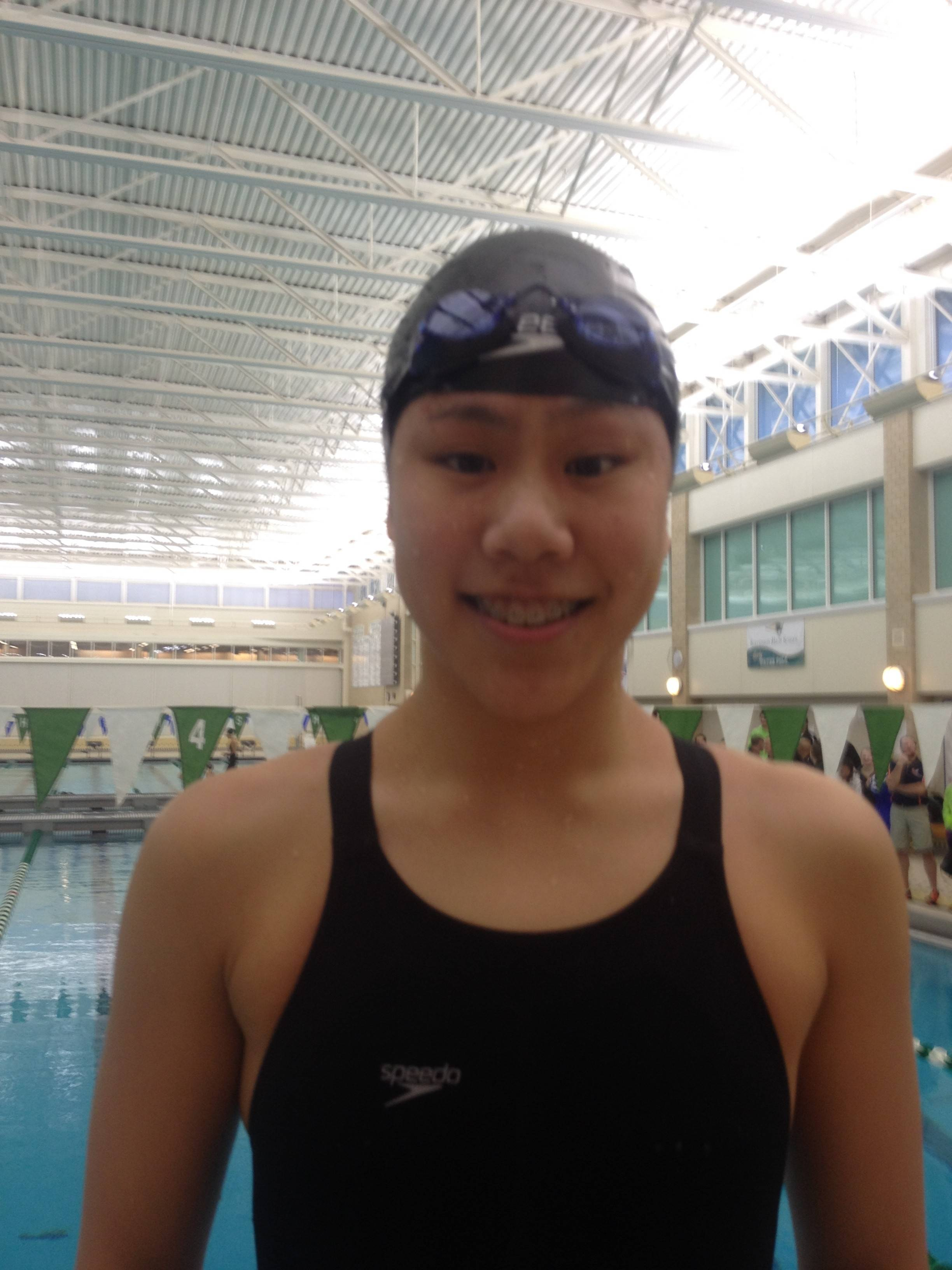 Stevenson sophomore Danielle Fang displays her fourth-place medal after the 100-yard breaststroke in the sectional meet hosted by the Patriots on Saturday.
