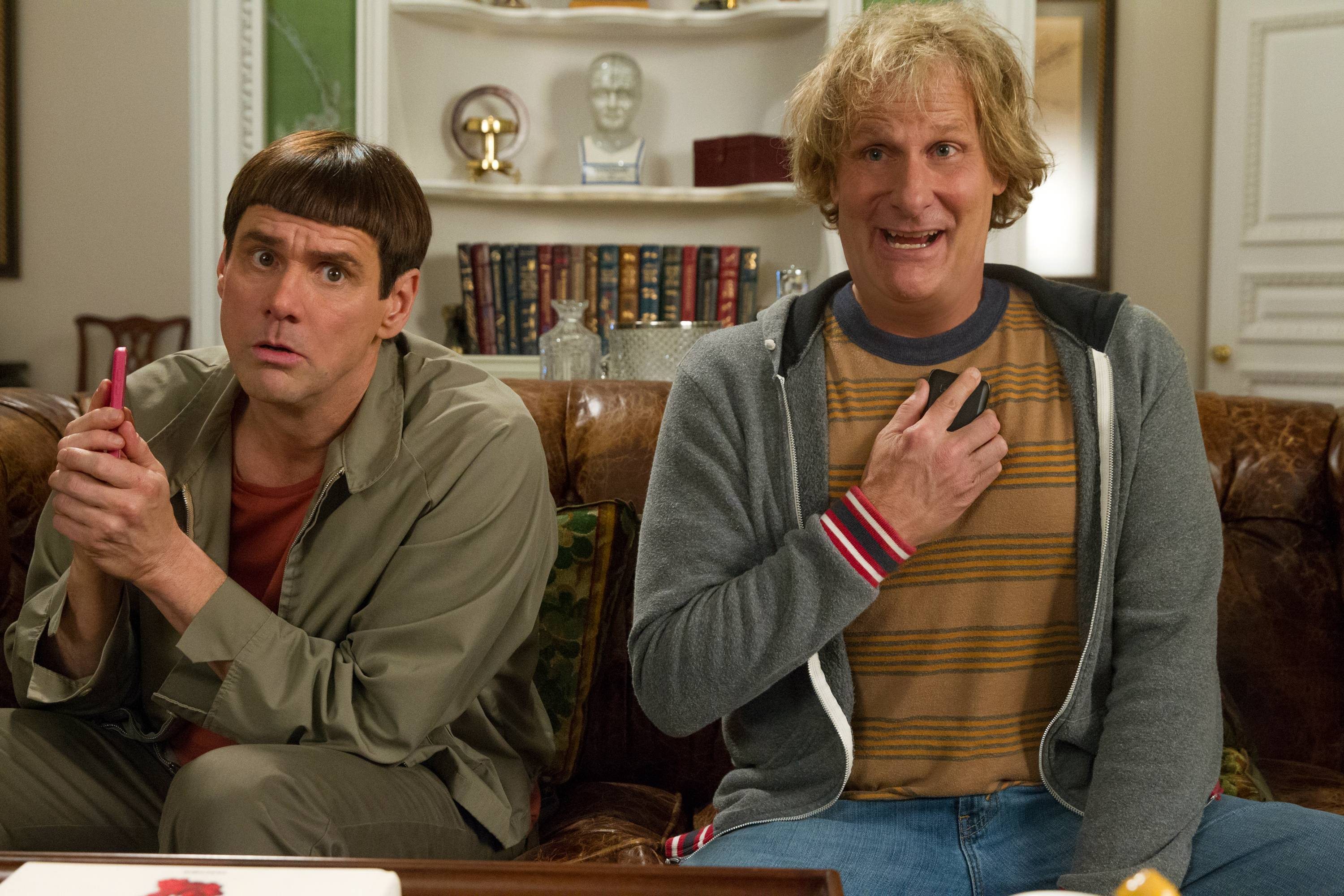 "Jim Carrey, left, and Jeff Daniels reprise their roles 20 years later for the sequel ""Dumb and Dumber To,"" which debuted at No. 1 at the box offcie"