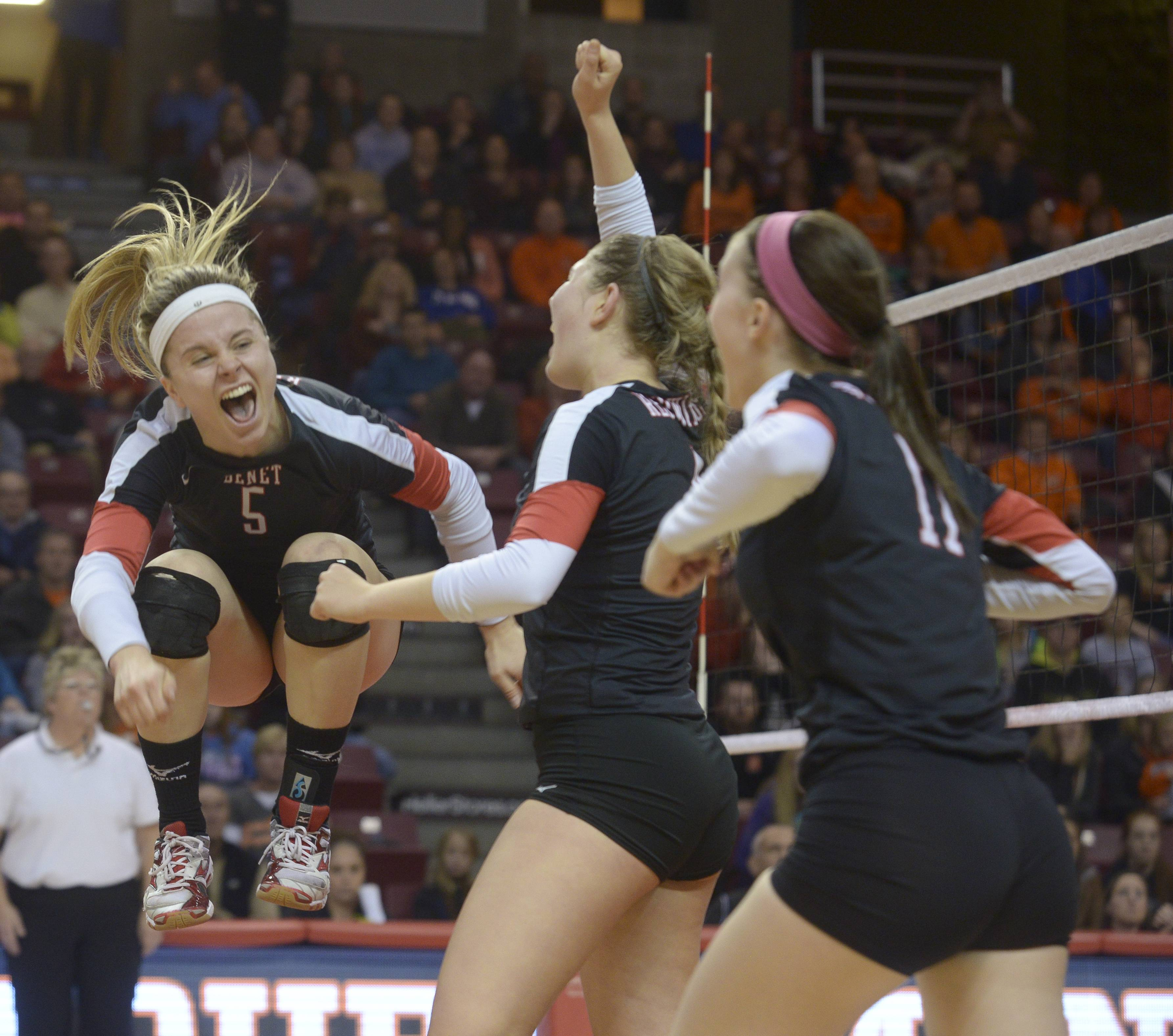 Benet's Tiffany Clark jumps for joy as they defeat Normal Community during the Girls volleyball, Class 4A state semifinal.