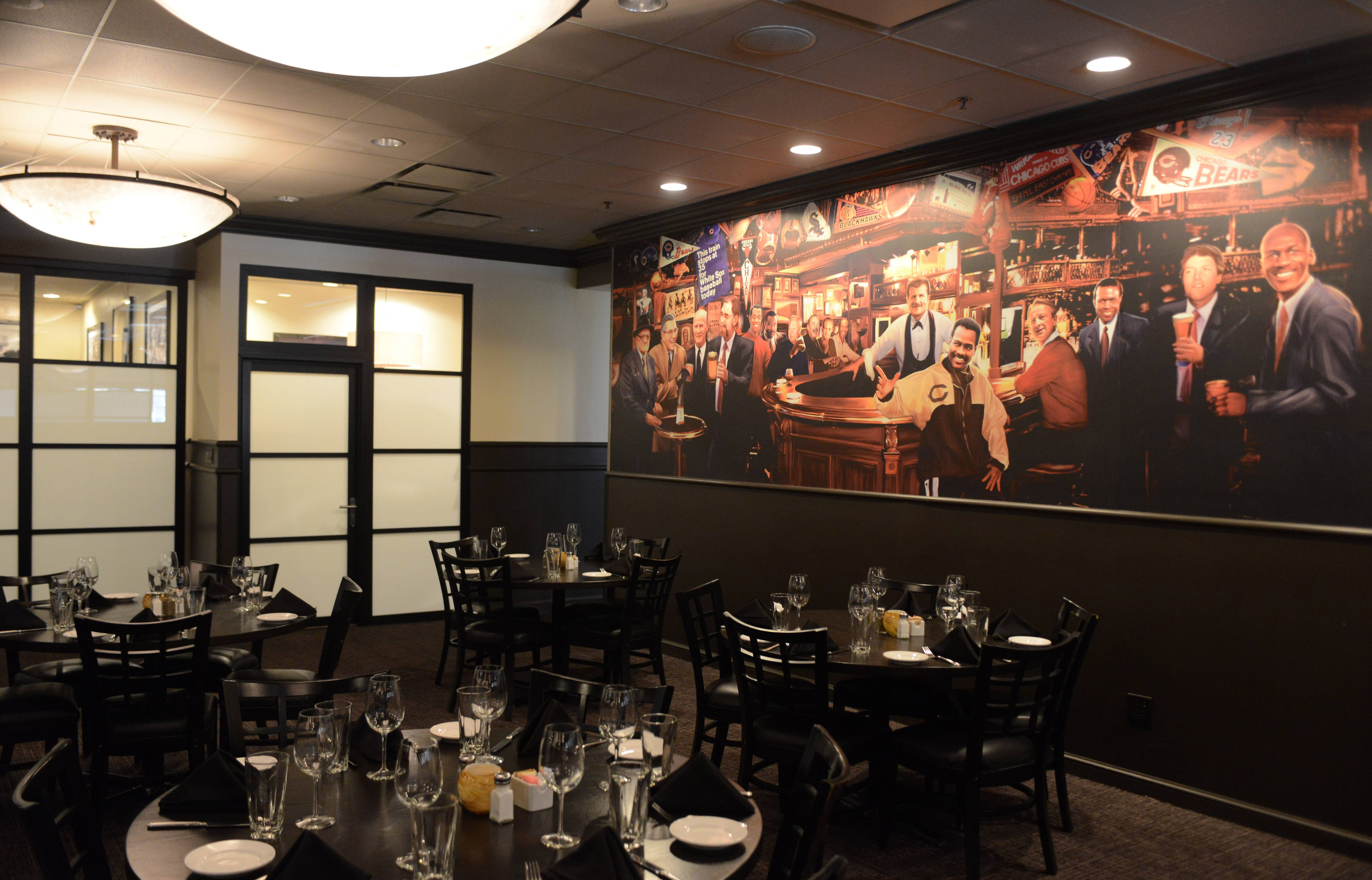 A mural celebrating Chicago sports legends greets diners at Ditka's Restaurant in Arlington Heights.