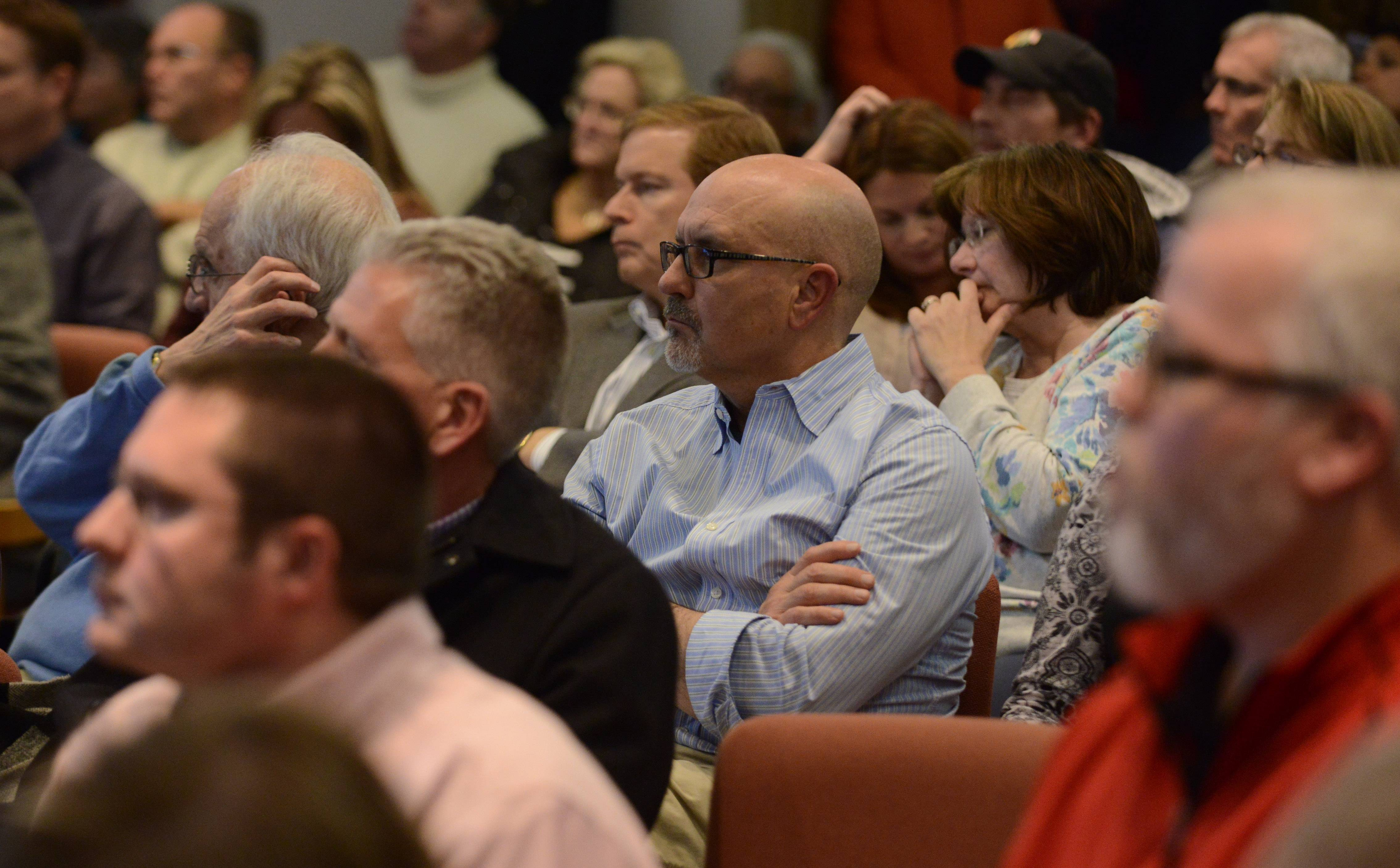 Audience members listen to a presentation during the Lake Barrington village board meeting Wednesday about a controversial Speedway gas station at the intersection of Northwest Highway and Kelsey Road.